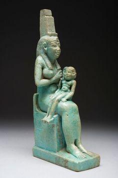 Faience statuette of Isis suckling Horus.