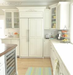Love white kitchens!  marble counters, wood island.