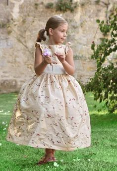 Love this ivory and glod flower girl dress embroidered with pink flowers!! Check it out now on littleeglantine.com! #wedding