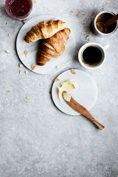 Breakfast; Fresh Croissants with butter & raspberry jam and coffee.