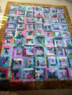 This beautiful quilt top was machine pieced, pressed, squared up and ready to be quilted. This quilt top was made using beautiful batik fabrics with a lot of different color tones but fall towards the