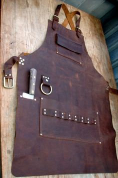 Leather Apron with knife sheath pocket and towel by CyclonaDesigns https://www.etsy.com/listing/475473945/custom-fixed-blade-knife-handmade-sheath?ref=shop_home_active_12