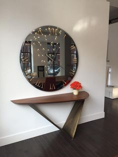 Reflex Titanium wall mirror and Prisma console table. Designed and crafted in Italy.