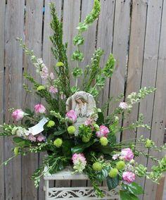 Angel plaque with fresh flower arrangement
