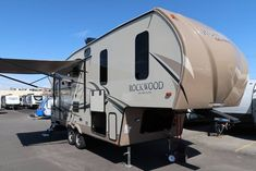 Forest River RV Rockwood Ultra Lite fifth wheel model 2440BS highlights: Countertop Extention Two Slide Outs Rear Living This Rockwood Ultra Lite... #RO880277
