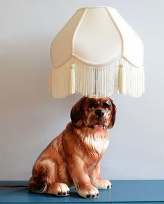 Upcycled ceramic dog lamp with cream tasselled lampshade and inline switch.