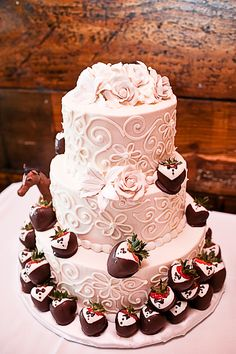 wedding cake, bride and groom cake combination, chocolate covered strawberries, horse figurine