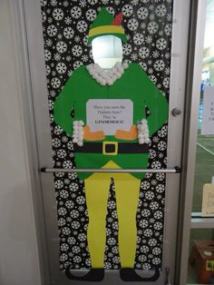 "Reminiscing the door decoration @chickarocka and I made last year. We won they competition too. Signs said ""have you seen the trainers here? They're GINORMOUS!"" ""The best way to spread Christmas cheer is throwing free weights for all to hear"" ""you're not Santa- you smell like protein shakes and sweat!"" That was a great door!"