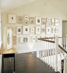 Love the white  mats used!  Gallery Wall on Stair Landing