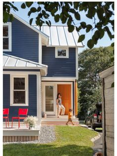 Navy blue house colour with bright red, yellow or orange door