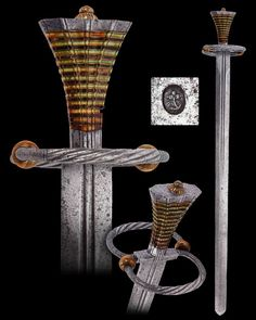 "An Austrian Landsknecht Sword (Katzbalger), early 16th century  The grip bears 23 light and dark stained bone plates and between them small plates of brass. The central fuller is struck with a cherry-shaped maker's mark.  Overall length: 87 cm (34.25""); Blade length: 73.1 cm (28.8"")  Located at Reichsstadtmuseum Rothenburg, Germany"