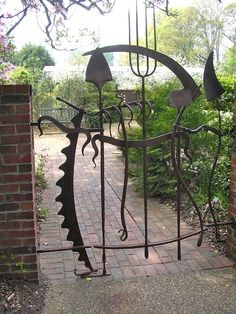 Take your old garden tools, bend them in interesting ways, find a friendly welder and you have a custom made garden gate. A work of art.