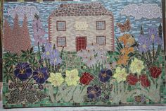 "My first very large mosaic wall hanging. Mixture of ceramic and glass tiles as well as plastic beads. Used scrabble letters too to spell ""Home Sweet Home"". Cut glass flower and leaf shapes."