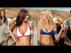 Models play volleyball over Mexican border wall in Carl's Jr. ad alluding to immigration debate - InsiderSizzle.com