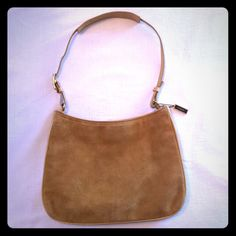Vintage Suede Coach Vintage suede Coach purse. Some marks on the suede(see picture) interior in great shape, interior zipper works, leather handle good, only one small spot. Magnetic button closure. Keeping with the suede trend! Coach Bags Shoulder Bags