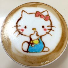 With all due respect, Ms. Kitty, are you flipping us the bird? Done by @nowtoo. #InkedMagazine #coffee #latte #art #foodart #HelloKitty