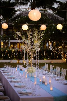 Blue table runner. Floral trees, tea lights and nakin decorated with blue ribbon.  Lighting of chinese lanterns and fairy lights. Fairy Lights, Tea Lights, Chinese Lanterns, Blue Ribbon, Beautiful Islands, Unique Weddings, Table Runners, Florals, Trees