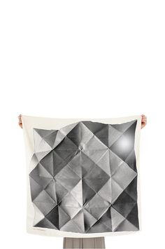 Folded Paper Furoshiki scarf looks awesome pinned to canvas, as in: http://www.apartmenttherapy.com/cheap-yet-chic-8-living-room-ideas-for-little-to-no-money-201679#comments