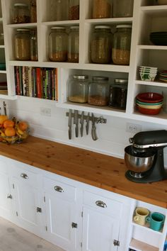 """A custom built kitchen dresser - """"A custom built kitchen dresser  This image shows how a built in kitchen dresser with warm wood countertops, open shelving and vintage style cupboards can give a small kitchen plenty of usable space and storage."""""""