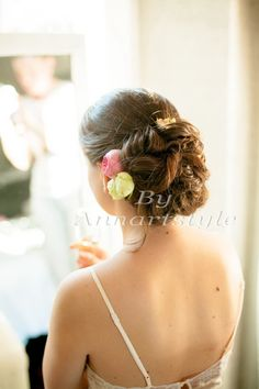 Bridal hairstyle, updo with flowers