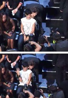 Harry posing with Rihanna!
