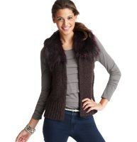 """Petite Faux Fur Collar Vest - Hit the slopes—or the street—in a cozy glam vest crafted with a delightfully nubby texture, plus a faux fur collar for a touch of exotic flair. Faux fur collar. Ribbed at armholes and hem. Hidden hook-and-eye closure. 20 1/2"""" long."""