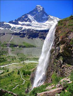 Matterhorn viewed from Zermatt leading up to the Schonbielhutte with the Arbenbach waterfall in foreground, Valais canton, Switzerland.