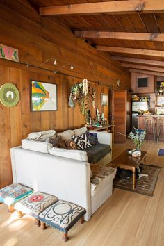 Chris and Madgi's Gem of a Beach Cabin is part of Chris And Madgis Gem Of A Beach Cabin Apartment Therapy 2 years; Rented Soulmates Chris and Madgi live to explore Mother Earth Both artists, they - Knotty Pine Rooms, Knotty Pine Decor, Knotty Pine Kitchen, Cedar Walls, Wood Panel Walls, Cabin Homes, Loft, Apartment Therapy, Home Remodeling