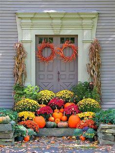 great fall deco. Love the orange wreaths.
