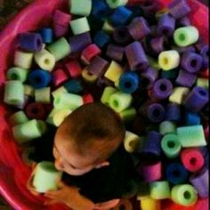 Baby pool full of cut up pool noodles....makes a fun playtime!