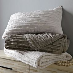 Rows of frayed edges give this West Elm Frayed-Edge Quilt and Shams ($29-$189) an airy feel. Layer it with a throw and patterned duvet for extra warmth and texture in the cooler months.
