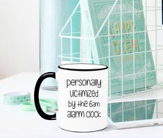 Personally Victimized by the 6am Alarm Clock Mug, Funny Mug, Funny Gift, Gag Gift, Coworker Gift, Work Mug, Coworker Mug, Work Gift, PICTURED 6am Alarm Clock Mug DETAILS: 1. 11oz or 15oz ceramic mug (chosen at checkout) 2. Image is printed on both sides 3. Dishwasher (top rack) and microwave safe   Our Orca sealed ceramic coffee mugs are made using a high quality sublimation process that adheres specialty inks to our mugs, leaving a permanent image on your mug! The images will not rub, peel…