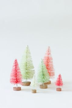 Tiny DIY gold dipped bottle brush trees. Love the modern shape & color palette!