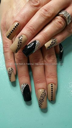 Clients own nude polish with black, swarovski crystals and freehand leopard print nail art