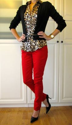 Cheetah blouse red pants and black pumps and cardigan to complete the outfit.