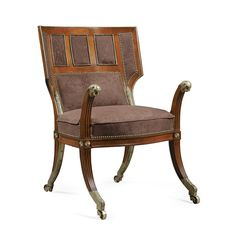 A Russian gilt-bronze-and brass-mounted mahogany winged armchair (fauteuil d' officier), circa 1800.