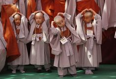 itty Buddhist Monks with freshly shaved heads.