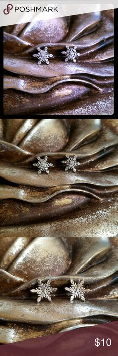 Rhodium plated snowflake earrings Super cute for winter,these snowflake earrings sparkle!! The rhodium is super shiny. Posts are the tiniest bit bent,but it doesnt effect the way they look or how they go into your ear lobe. other Jewelry Earrings