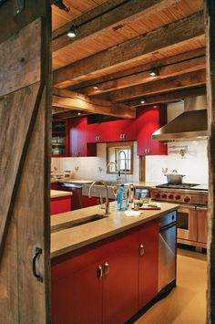 modern meets cabin. love the red. I could move right into this kitchen.