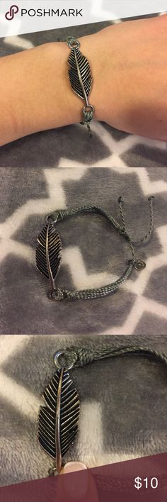 Pure Vida Bracelet Gray Leaf Pure Vida Bracelet. Has two string for adjustable wrist size. Worn a number of times but still in good condition. Pure Vida Jewelry Bracelets