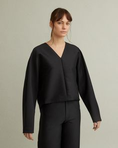 V-neck structured dolman sleeve top. V-neckline Wide, cropped body Dolman sleeve Cotton Wool Polyamide Model is 178 ft 10 in and is wearing a size S Jil Sander, V Neck Tops, Marni, Designing Women, Fashion Brands, Bell Sleeve Top, Apothecary, Model, Cotton