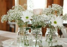 Perfect for barn weddings. Mason jars can be an easy DIY project to make beautiful but inexpensive centerpieces or flower arrangements. They add the perfect amo Garden Party Decorations, Reception Decorations, Gerbera, Garden Party Wedding, Wedding Table, Wedding Flower Arrangements, Wedding Flowers, Bouquet Champetre, Wedding Centerpieces Mason Jars