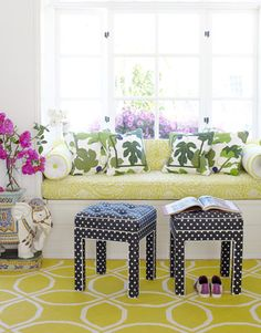 Adding plenty of pop to a California bungalow, designer Krista Ewart choose modern prints and bold patterns for a favorite reading spot. The window seat fabric is Acadia in sulphur by Raoul Textiles. The pillows are in Fiki by Ljungbergs Textiltryck.