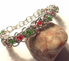 Christmas Elf Weave Chainmaille Bracelet - Jewelry creation by LolaJ Christmas Jewelry, Christmas Elf, Beaded Jewelry, Jewelry Bracelets, Chainmaille Bracelet, Weave, Beading, Silver Rings, Jewelry Making