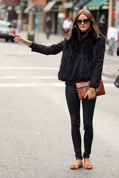 black fur vest over black blazer