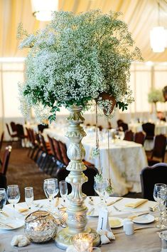 Babys Breath Reception Table Centerpiece.  Might be good to add live greenery and babys breath to your flowers