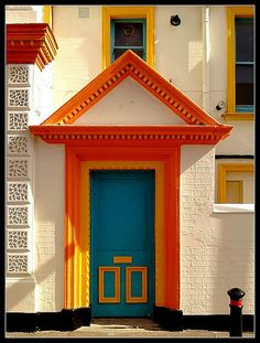 This door looks like it leads to a super fun house! Looking closely, where's the door knob? Hmm...