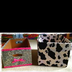 DIY storage box out of diaper boxes. Left: zebra duck tape & ribbon   Right: dalmatian print fabric Thanks Pinterest for giving me this idea!
