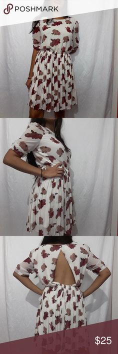 """Urban outfitters Pins and Needles white floral S Urban outfitters  Pins and Needles white   floral dress.   ♡ Semi backless  ♡ Pleated bottom ♡ Elastic waist    ♡Length: ~34 """" ♡Sleeve:~10.5"""" ♡underarm to underarm: ~17.5""""  ♡Pre-owned; great condition, no stain, no tear, or rips. ♡Due to studio lighting, product be may lighter or darker in pictures.  Offers Are Welcome Pins and Needles Dresses Backless"""