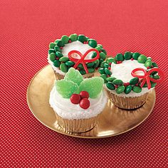 Super cute cupcakes from All You... I don't think I'll be making orange cupcakes during the holidays... for some reason orange doesn't scream Christmas to me!  I will however make my own cupcakes and use their ideas to decorate!  I will try the orange cup cakes during spring or summer... with different decorations of course!